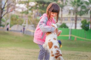 Vaccines help protect this girl and dog